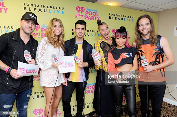 Hosts Billy The Kidd and Anne Hudson pose with Joe Jonas Cole Whittle JinJoo Lee and Jack Lawless of DNCE at 2016 iHeartRadio Summer Pool Party at...