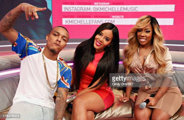 Hosts Bow Wow and Angela Simmons pose with singer K Michelle during BET's '106 and Park' at BET Studios on August 12 2013 in New York City