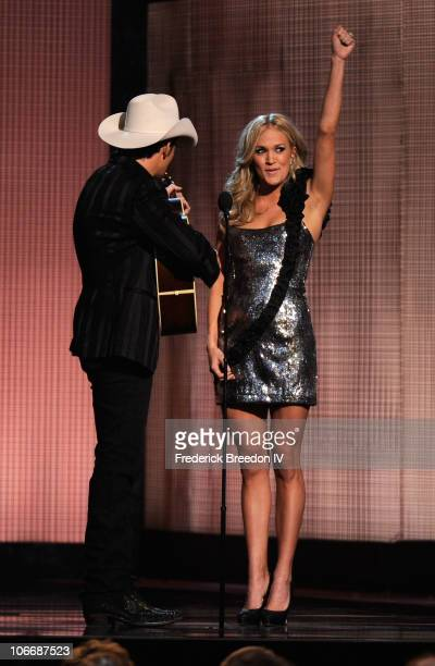 Hosts Brad Paisley and Carrie Underwood speak onstage at the 44th Annual CMA Awards at the Bridgestone Arena on November 10 2010 in Nashville...