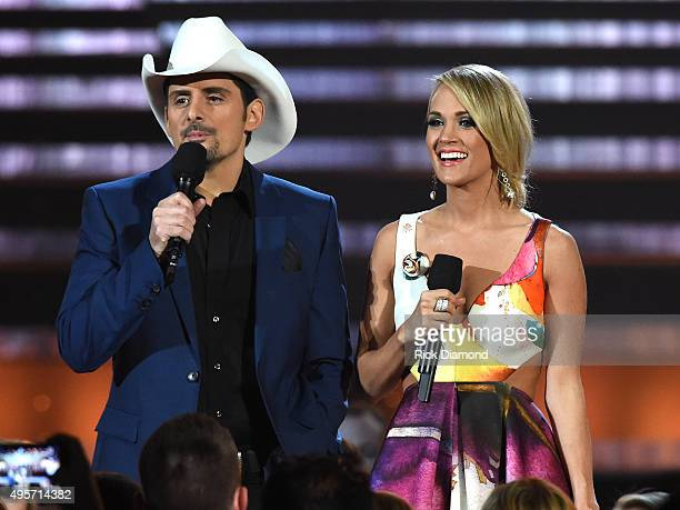 Hosts Brad Paisley and Carrie Underwood speak onstage at the 49th annual CMA Awards at the Bridgestone Arena on November 4 2015 in Nashville Tennessee