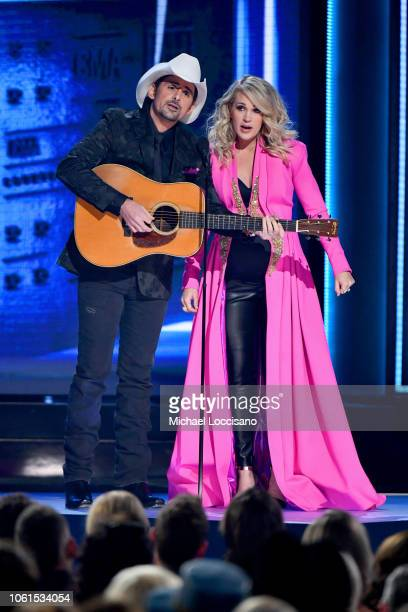 Hosts Brad Paisley and Carrie Underwood speak onstage during the 52nd annual CMA Awards at the Bridgestone Arena on November 14 2018 in Nashville...