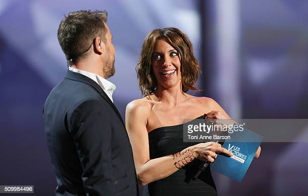 Hosts Bruno Guillon and Virginie Guilhaume during 'Les Victoires De La Musique' at Le Zenith on February 12 2016 in Paris France