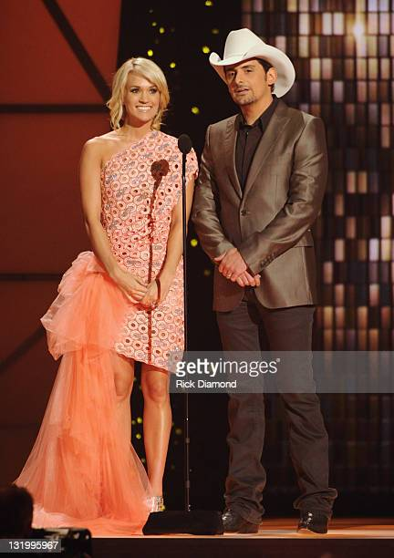 Hosts Carrie Underwood and Brad Paisley speak at the 45th annual CMA Awards at the Bridgestone Arena on November 9 2011 in Nashville Tennessee