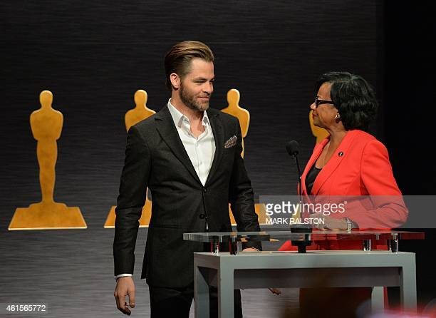 Hosts Chris Pine and Academy President Cheryl Boone smile during the Academy Awards Nominations Announcement at the Samuel Goldwyn Theater in Beverly...