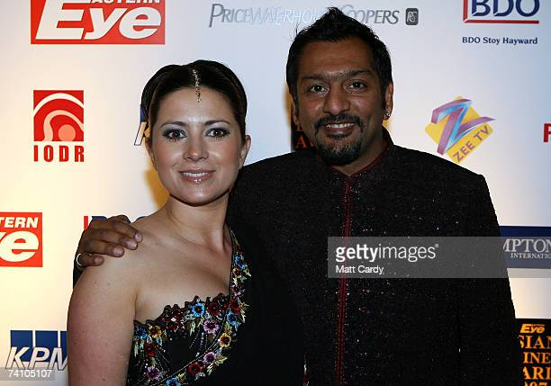 Hosts Clare Nasir and Nitin Ganatra pose at the Eastern Eye Asian Business Awards May 8 2007 in London The awards in the 11th year celebrate the...