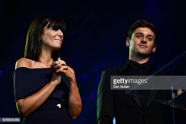 Hosts Claudia Winkleman and Tom Daley onstage at the Team GB Ball at Battersea Evolution on November 30 2016 in London England