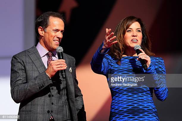 Hosts Dan Hicks and Michele Tafoya speak during the 2016 Ryder Cup Opening Ceremony at Hazeltine National Golf Club on September 29 2016 in Chaska...