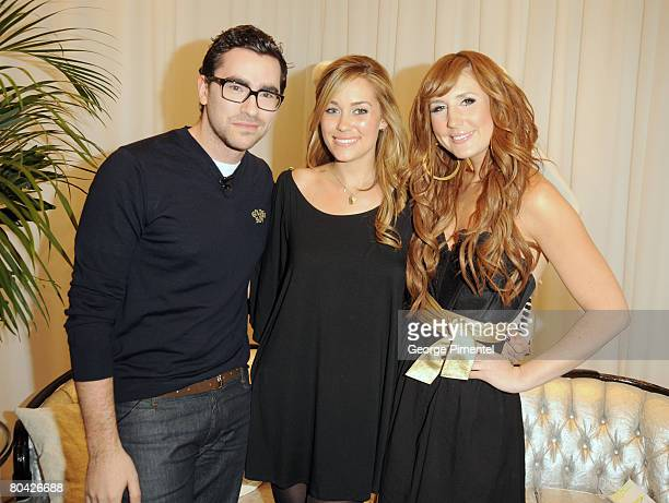 Hosts Dan Levy and Jessi Cruickshank pose with Lauren Conrad as she launches her Womenwear at Holt Renfrew Yorkdale location on March 29 2008 in...