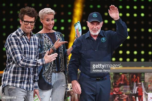 TV hosts Daniel Hartwich and Sonja Zietlow with Robert McCarron aka Dr Bob attend the 1st live show of the television show 'Ich bin ein Star lasst...