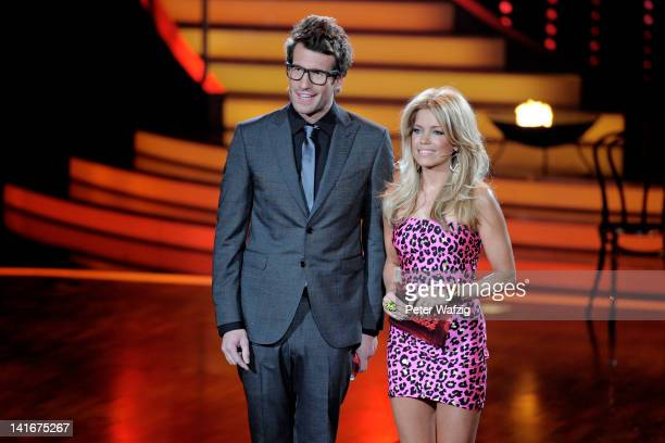 Hosts Daniel Hartwich and Sylvie van der Vaart speak during the 'Let's Dance' TV Show on March 21 2012 in Cologne Germany