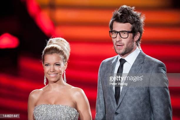 Hosts Daniel Hartwich and Sylvie van der Vaart talk during 'Let's Dance' Semi Finals at Coloneum on May 16 2012 in Cologne Germany