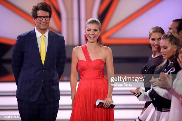 Hosts Daniel Hartwich and Victoria Swarovski speal on stage during the 5th show of the 11th season of the television competition 'Let's Dance' on...