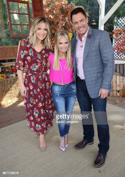 Hosts Debbie Matenopoulos and Mark Steines pose with actress Kristin Chenoweth at Hallmark's 'Home Family' at Universal Studios Hollywood on October...