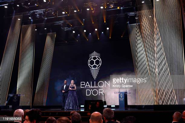 Hosts Didier Drogba and Sandy Heribert are seen onstage during the Ballon D'Or Ceremony at Theatre Du Chatelet on December 02 2019 in Paris France