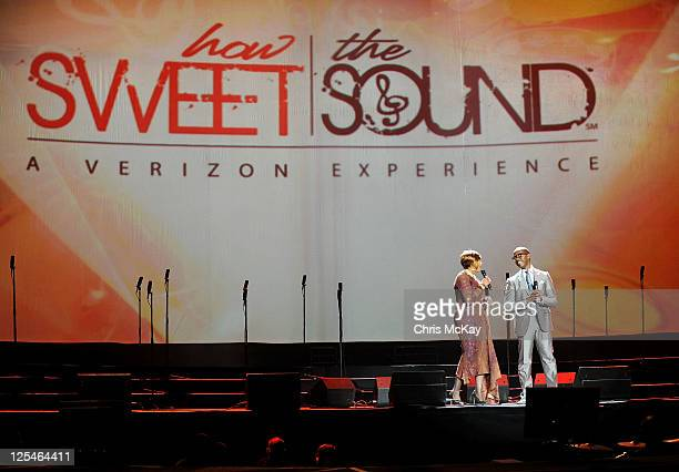 Hosts Dorinda ClarkCole and Donald Lawrence perform during Verizon's How Sweet The Sound 2011 at Philips Arena on September 17 2011 in Atlanta Georgia