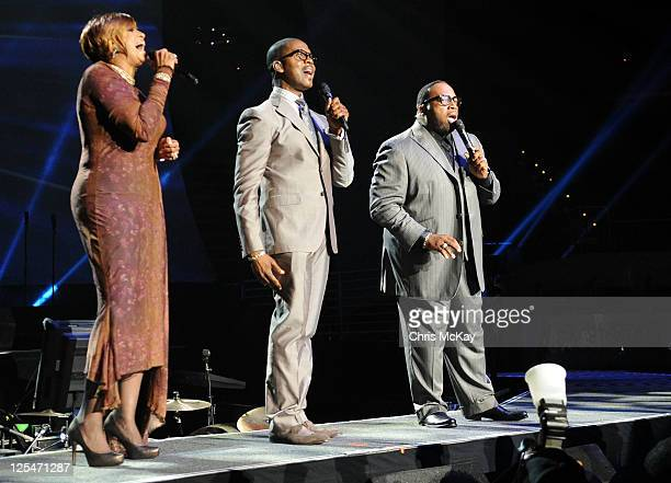 Hosts Dorinda ClarkCole and Donald Lawrence perform with judge Marvin Sapp during Verizon's How Sweet The Sound 2011 at Philips Arena on September 17...
