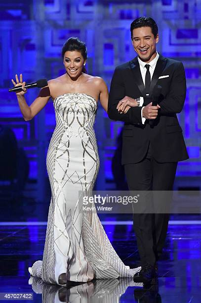 Hosts Eva Longoria and Mario Lopez speak onstage during the 2014 NCLR ALMA Awards at the Pasadena Civic Auditorium on October 10 2014 in Pasadena...