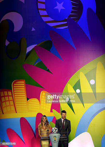 Hosts Fernanda Lima and Rodrigo Hilbert speak to the audience before the Final Draw for the 2014 FIFA World Cup Brazil at Costa do Sauipe Resort on...