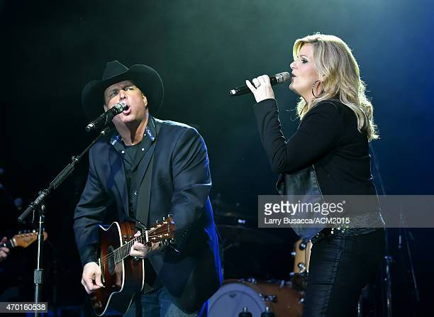 Hosts Garth Brooks and Trisha Yearwood perform onstage during the ACM Lifting Lives Gala at the Omni Hotel on April 17 2015 in Dallas Texas