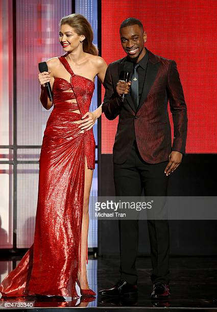 Hosts Gigi Hadid and Jay Pharoah speak onstage during the 2016 American Music Awards held at Microsoft Theater on November 20 2016 in Los Angeles...
