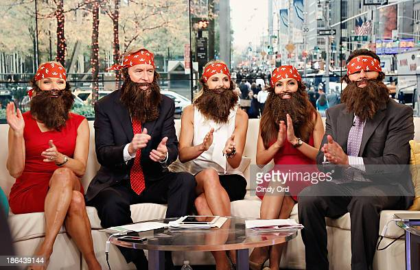 Hosts Heather Childers Steve Doocy Elisabeth Hasselbeck Brian Kilmeade and Maria Molina wear 'Duck Dynasty' costumes as FOX Friends celebrates...