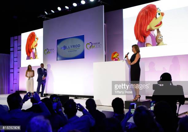 Hosts Holly Robinson Peete and Rodney Peete present the first autistic Sesame Street muppet Julia with the HollyRod Corporate Compassion Award to...