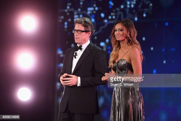 Hosts Hugh Grant and Kate Abdo talk on stage during the 2017 Laureus World Sports Awards at the Salle des EtoilesSporting Monte Carlo on February 14...