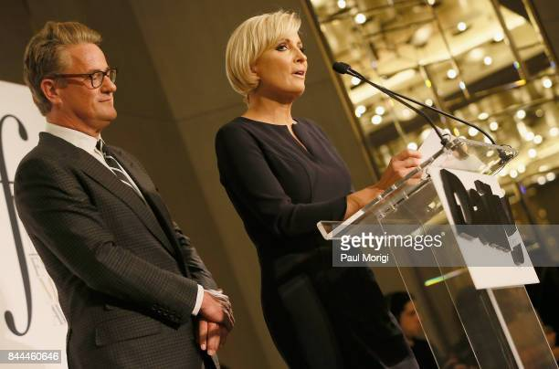 MSNBC hosts Joe Scarborough and Mika Brzezinski present an award onstage during the Daily Front Row's Fashion Media Awards at Four Seasons Hotel New...