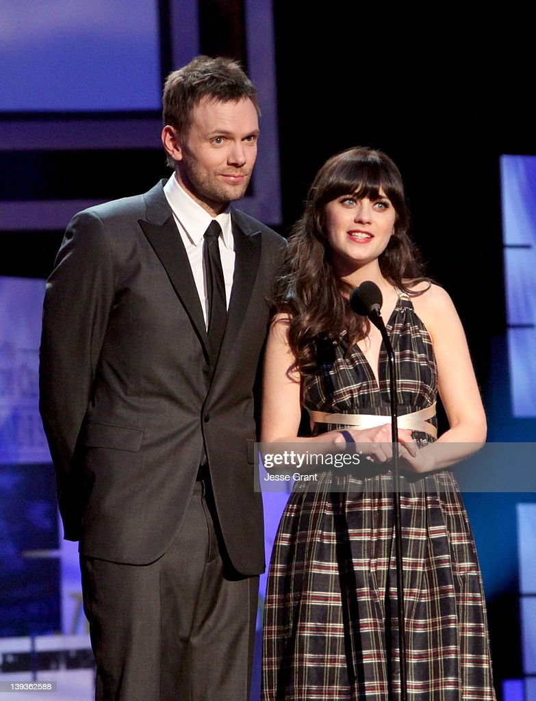 Hosts Joel McHale (L) and Zooey Deschanel attend the 2012 Writers Guild Awards at the Hollywood Palladium on February 19, 2012 in Los Angeles, California.