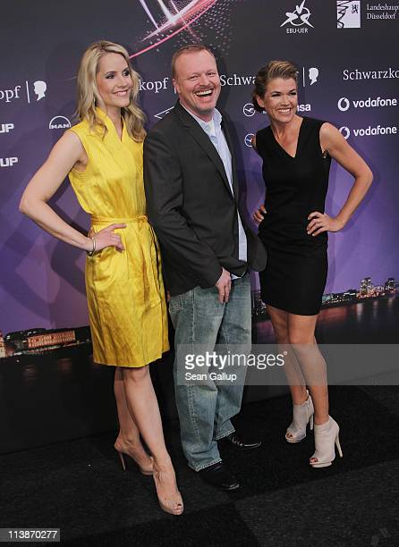 Hosts Judith Rakers, Stefan Raab and Anke Engelke attend a photocall the day before the first semi-finals of the Eurovision Song Contest 2011 on May...