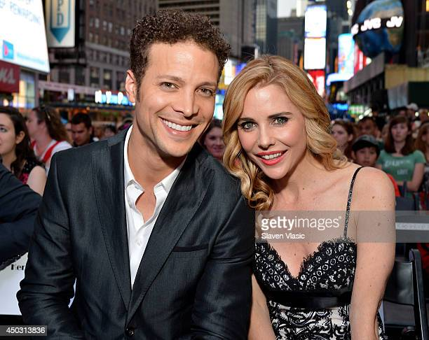 Hosts Justin Guarini and Kerry Butler pose on stage during the 68th Annual Tony Awards Times Square Simulcast at Times Square on June 8 2014 in New...