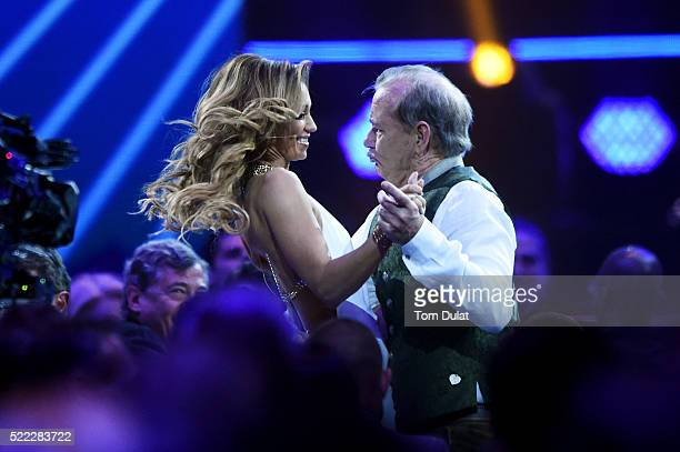 Hosts Kate Abdo and Bill Murray dance on stage during the 2016 Laureus World Sports Awards at the Messe Berlin on April 18 2016 in Berlin Germany