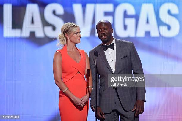 Hosts Kathryn Tappen and Anson Carter speak onstage before presenting the Masterton Trophy during the 2016 NHL Awards at The Joint inside the Hard...