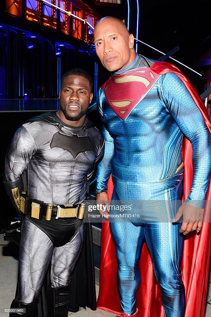 Hosts Kevin Hart (L) and Dwayne Johnson pose backstage at the 2016 MTV Movie Awards at Warner Bros. Studios on April 9, 2016 in Burbank, California. MTV Movie Awards airs April 10, 2016 at 8pm ET/PT.