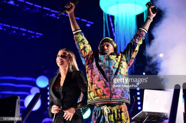 Hosts Lele Pons and Nick Cannon speak onstage during FOX's Teen Choice Awards at The Forum on August 12 2018 in Inglewood California