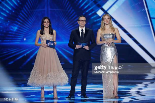 Hosts Lucy Ayoub Erez Tal and Bar Refaeli live on stage during the 64th annual Eurovision Song Contest held at Tel Aviv Fairgrounds on May 18 2019 in...
