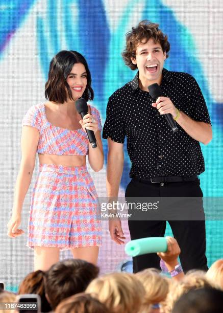 Hosts Lucy Hale and David Dobrik speak onstage during FOX's Teen Choice Awards 2019 on August 11 2019 in Hermosa Beach California