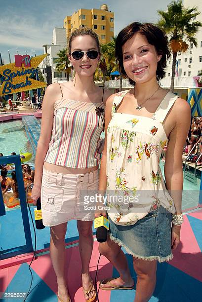 Hosts Mandy Moore and Hilarie Burton pose for a photo during a taping for MTV Spring Break 2003 at the Surfcomber Hotel March 14 2003 in Miami Beach...