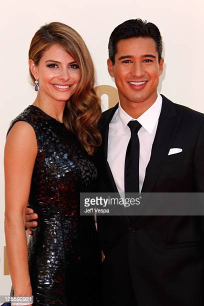 TV hosts Maria Menounos and Mario Lopez arrive to the 63rd Primetime Emmy Awards at the Nokia Theatre LA Live on September 18 2011 in Los Angeles...
