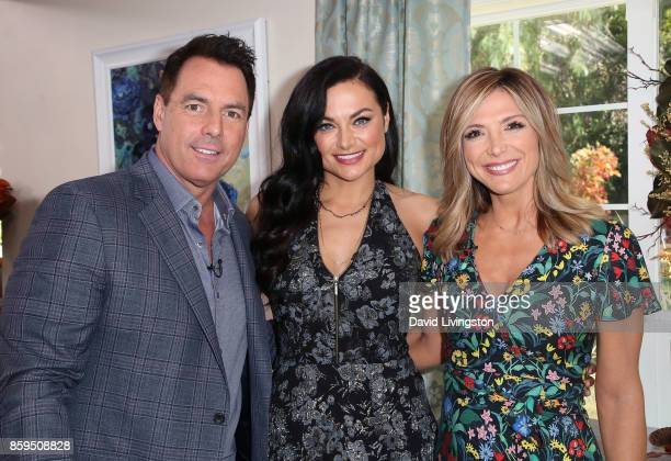 Hosts Mark Steines and Debbie Matenopoulos pose with actress Christina Ochoa at Hallmark's Home Family at Universal Studios Hollywood on October 9...