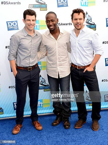 Hosts Max Greenfield Lamorne Morris and Jake M Johnson arrives at the 2012 Do Something Awards at Barker Hangar on August 19 2012 in Santa Monica...