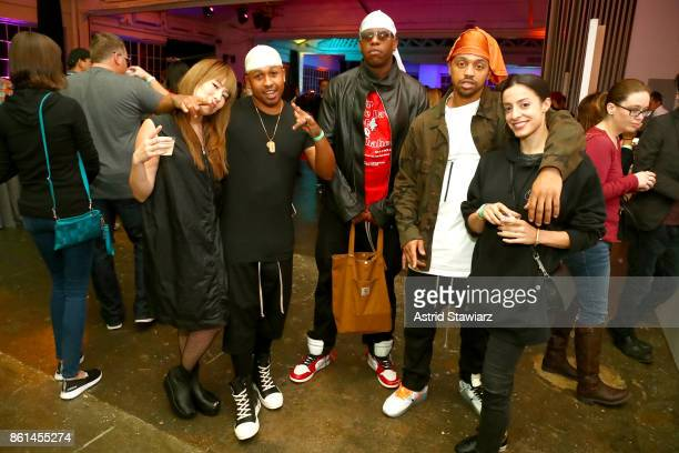 Hosts musicians and chefs Ghetto Gastro pose with guests during Street Eats hosted by Ghetto Gastro at Industria on October 14 2017 in New York City