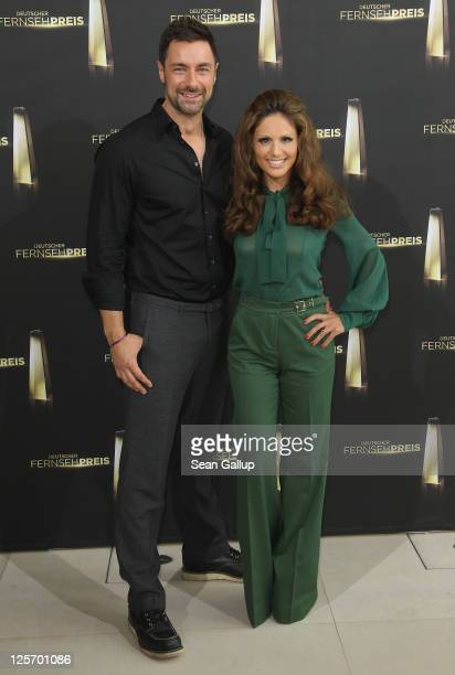 Hosts Nazan Eckes and Marco Schreyl pose at a reception for the German Television Awards nominees at the Bertelsmann building on September 21 2011 in...