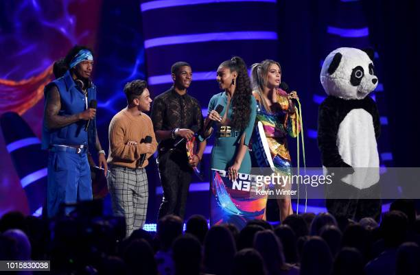 Hosts Nick Cannon Lele Pons present the award for Choice Breakout TV for the show On My Block to actors Diego Tinoco Jason Genao Brett Gray and...