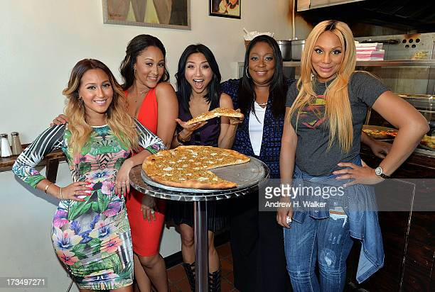 """Hosts of """"The Real,"""" Adrienne Bailon, Tamera Mowry-Housley, Jeannie Mai, Loni Love and Tamar Braxton stop at New York City's Artichoke Pizza as part..."""