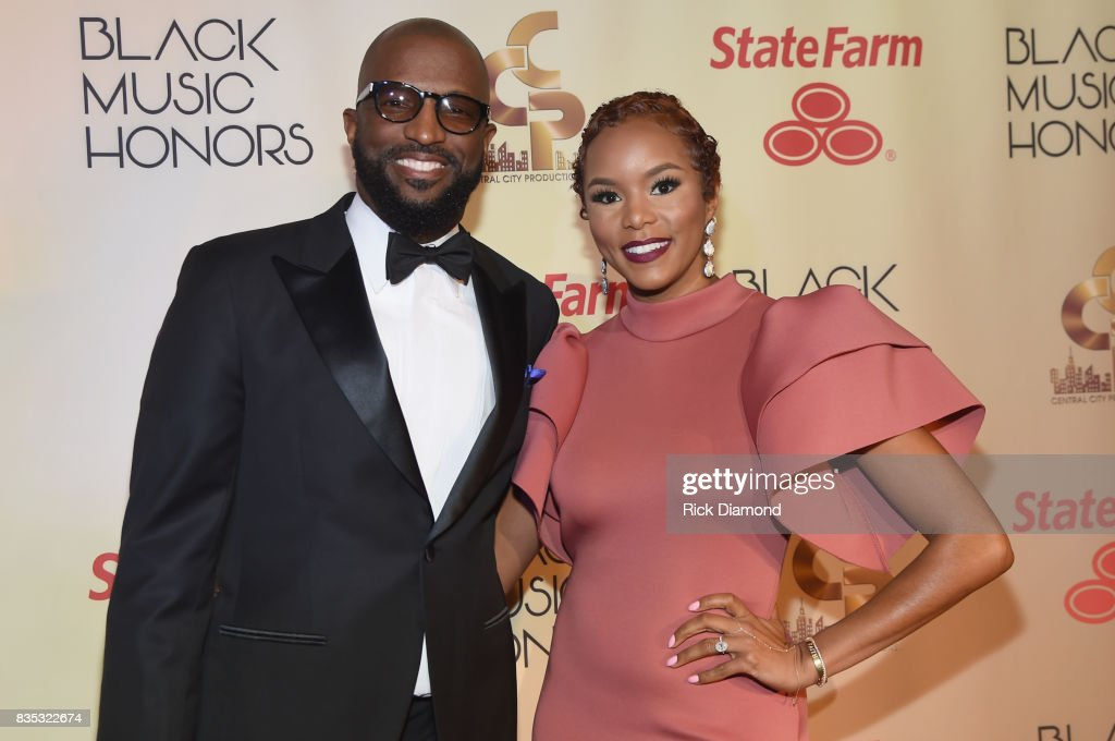 Hosts Rickey Smiley (L) and Letoya Luckett (R) arrive at the 2017 Black Music Honors at Tennessee Performing Arts Center on August 18, 2017 in Nashville, Tennessee.