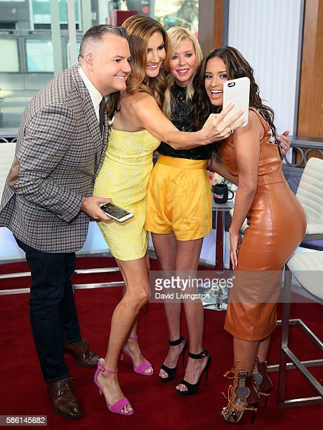 Hosts Ross Mathews and Heather McDonald actress Tara Reid and host Rocsi Diaz pose for a selfie at Hollywood Today Live at W Hollywood on August 5...