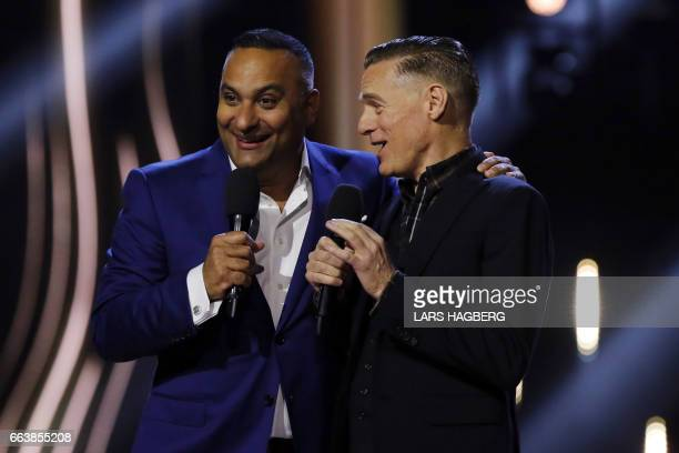 Hosts Russell Peters jokes on stage with Bryan Adams during the JUNO Awards at the Canadian Tire Centre in Ottawa Ontario on April 2 2017 / AFP PHOTO...