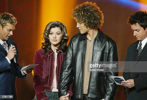 Hosts Ryan Seacrest and Brian Dunkleman with Kelly Clarkson and Justin Guarini before the announcement of the winner of American Idol at the Kodak...