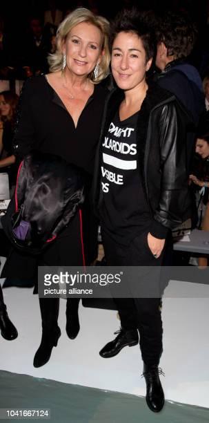 Hosts Sabine Christiansen and Dunja Hayali attend the Guido Maria Kretschmer fashion show during the Mercedes Benz FashionWeek in Berlin 21 January...
